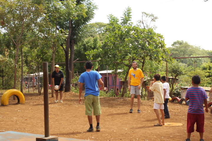 Ryan taking on the locals in a dusty game of futbol.