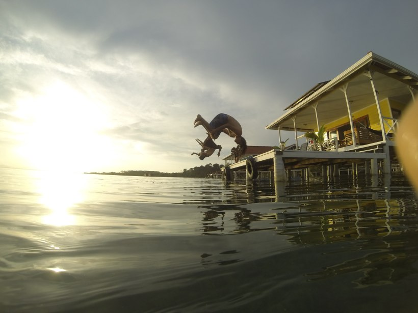 Doing backflips off the dock at our house.