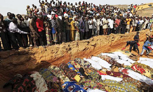 Mass burial of persecuted Christians in Nigeria. Story at: https://shariaunveiled.wordpress.com/tag/christian-persecution/