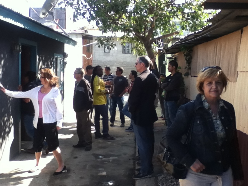 "Taking the board to visit the different ministries of YWAM San Jose, here we are in one of the communities ""Pavas"" were we build homes for low income families who cannot afford to fix their homes."
