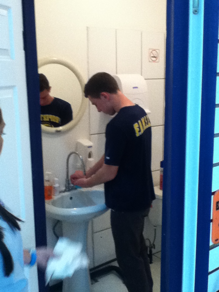 Station 1 was taking a shower, throwing away old clothes, and putting on new donated clothes.